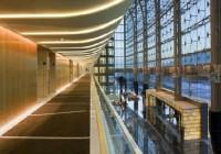 The Meydan Hotel - Concealed Slot Lighting at Guestroom Corridor Wood Walls